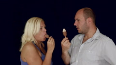 Couple eating ice cream bar together Stock Footage