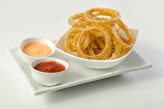 Onion rings and dip sauces - stock photo