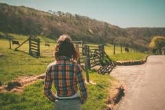 Young woman on a ranch - stock photo