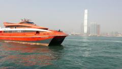 Turbo Jet Ferry approach to Macau Ferry terminal, tracking shot - stock footage