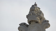 Sculpture of a rampant lion holding a monogram in Alba Iulia Stock Footage
