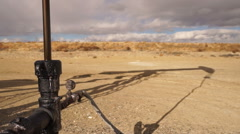 Pump Jack Shaft With Oil Well Shadow Dirt Wyoming - stock footage