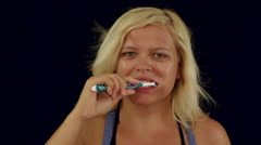 Woman brushing her teeth with tooth brush, fast motion Stock Footage