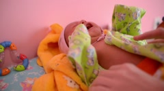 dressing newborn baby girl - cry and scream - stock footage