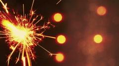 Firework sparkler burning on bokeh light background, greeting Stock Footage