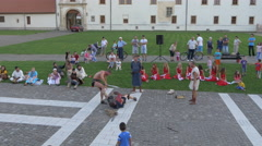 Men in medieval costumes fighting and performing in Alba Iulia fortress Stock Footage