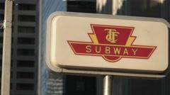 TTC Toronto Subway Sign Downtown. Panning shot. - stock footage