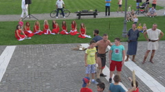 Man in medieval costume and boys performing in Alba Iulia fortress Stock Footage