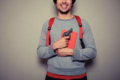 Student with gun and book - stock photo