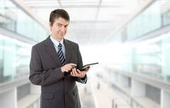 Businessman using touch pad of tablet pc, at the office Stock Photos