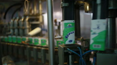 Manufacture and package of milk products - stock footage
