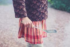 Young woman holding a spatula - stock photo