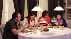 The family dined at a table and talking Stock Footage