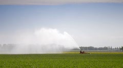 Irrigation gun in a field Stock Footage