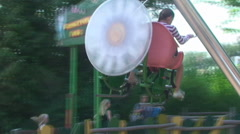 Germany. Holiday Park. Adults and children ride on the carousel in the Park Stock Footage