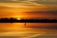 Germany, Lower Saxony, Leer, Oldersum, Moody sunset over sea bay - stock photo