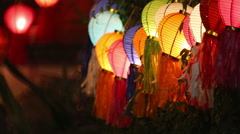 Asian lanterns on vine fence Stock Footage