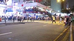 Hong Kong people crossing Nathan Road at night. Stock Footage