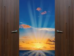 Dawn door open ocean - stock photo