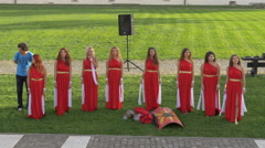 Women in medieval red dresses standing in the fortress of Alba Iulia Stock Footage