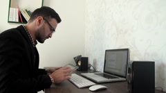 Bearded business man is working by pc in his office Stock Footage