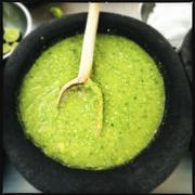 Bowl of spicy hot green chili sauce, Mexico - stock photo