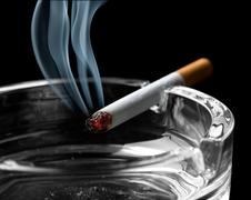 Cigarette on ashtray Stock Photos