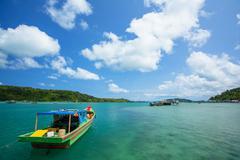 Indonesia, Riau Islands, Pulau Matak, Emerald Sea, Moored boat at bay Stock Photos