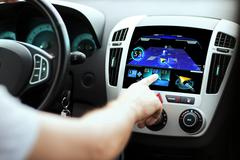 Male hand using navigation system on car dashboard Kuvituskuvat