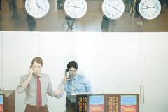 Two traders working in trading room Stock Photos