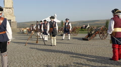 Stock Video Footage of Men in medieval costumes preparing to shoot the cannons in Alba Iulia