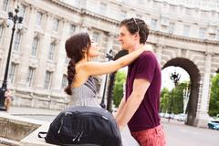 young couple by admiralty arch in london - stock photo