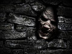Monster behind the wall - stock photo