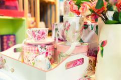 Vintage porcelain tea set on the table Stock Photos