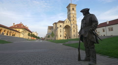 View of a bronze statue nearby the Saint Michael Cathedral in Alba Iulia Stock Footage