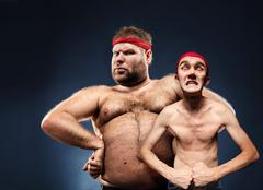 Funny body builders - stock photo