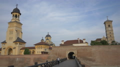 People exiting the fortress through the fourth gate in Alba Iulia Stock Footage
