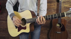 close up man strumming on acoustic guitar slow motion - stock footage