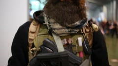 A man with a beard in uniform and with gun at Everycon Stock Footage