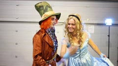 Pair in costumes the Mad Hatter and Alice (Alice in Wonderland) Stock Footage