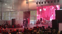 Person dressed as a plague doctor with wings on stage at Everycon Stock Footage