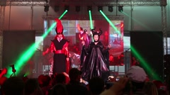 Cosplay Jafar (Aladdin) and Maleficent on stage at Everycon Stock Footage