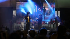 A man and woman in costumes with orange horns on stage Stock Footage