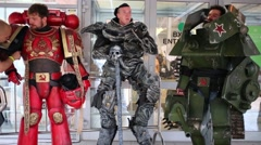 Three men in bulky costumes smokes at Sokolniki Stock Footage