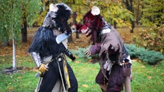 Two men in costumes rats fights in the park at Everycon Stock Footage