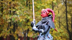A girl dressed as a Sith Inquisitor in the park at Everycon Stock Footage