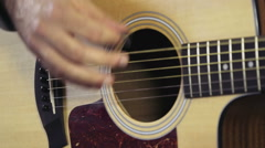 close up man hands playing the acoustic guitar slow motion - stock footage