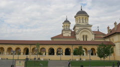 Stock Video Footage of People walking nearby the Coronation Cathedral in Alba Iulia