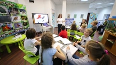 Children sits in spacious classroom in center for children Stock Footage