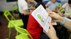 Teacher hand out certificates to children in center for children Stock Footage